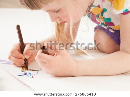 Little girl drawing  - closeup shot - stock photo