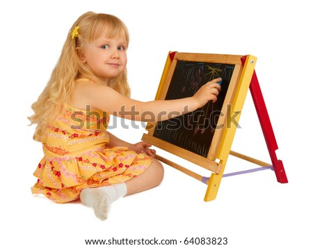 Little girl drawing on black board - stock photo