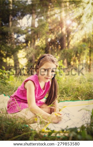 little girl drawing outdoors nature rest forest - stock photo