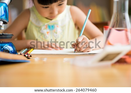 Little girl drawing with pencil, selective focus - stock photo
