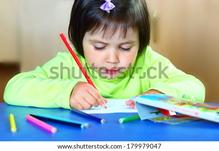 Little girl draws