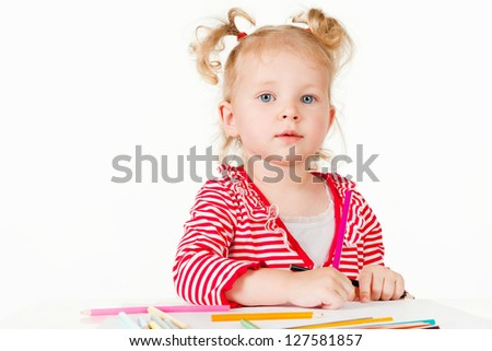 Little girl draws, on a gray background