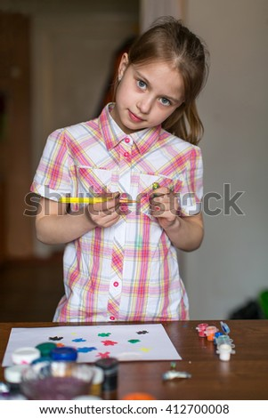 Little girl draws paints. - stock photo