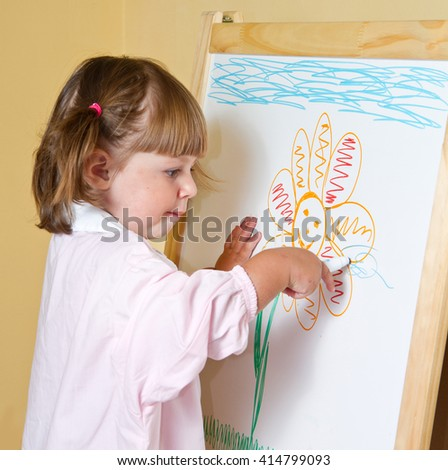little girl draws paints
