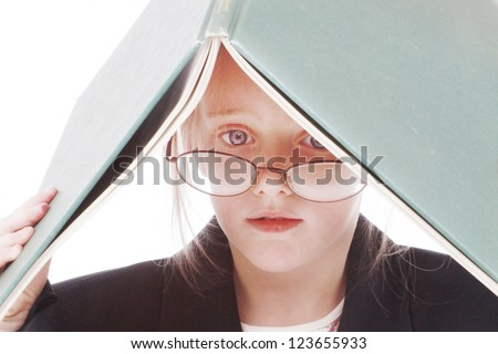 Little girl dressed as a business woman with a folder