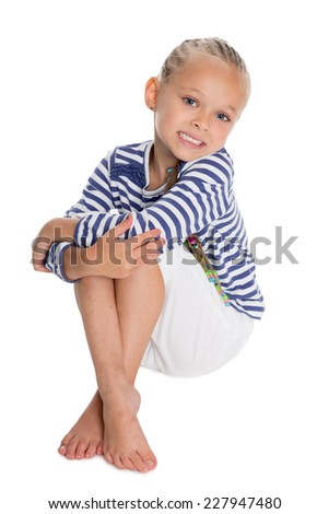 Little girl dressed as a sailor boy. Girl is six years old.  - stock photo