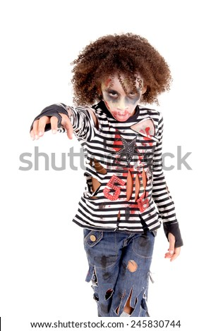 little girl dressed as a zombie on halloween isolated - stock photo