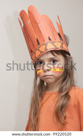 Little girl dressed as Indian with the painted face - stock photo