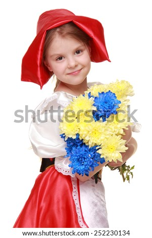 Little girl dressed as Little Red Riding Hood is holding a beautiful bouquet of blue and yellow chrysanthemums on white background - stock photo