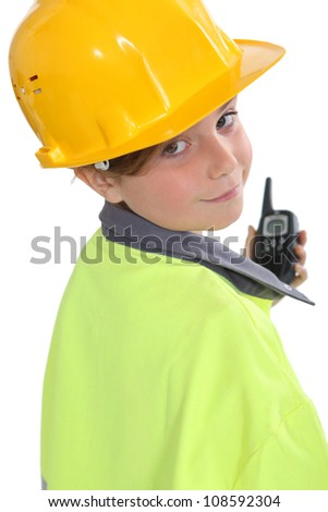 little girl dressed as site foreman - stock photo