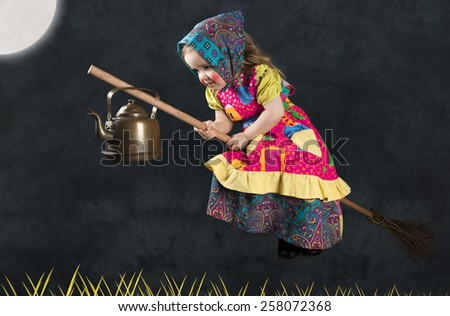 Little girl Dressed As Traditional Finnish Easter Witch - stock photo