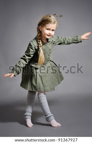 little girl dressed in the New Year on a gray background - stock photo
