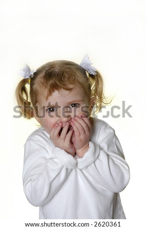 Little girl dressed in white making faces expressions