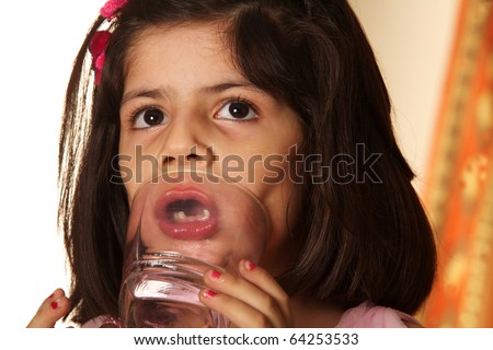 Little girl drink the water. Isolated on white - stock photo