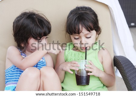 Little girl drinking a soft drink  - stock photo