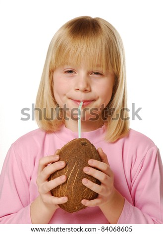 Little girl drinking coconut water. Little kid eating a coconut. - stock photo