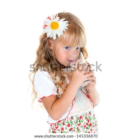 Little girl drinking milk isolated on white background - stock photo