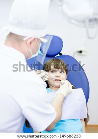 little girl during inspection of oral cavity  - stock photo