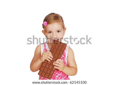 little girl eat large chocolate - stock photo