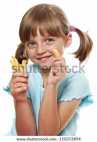 little girl eating a french fries isolated on white background - stock photo