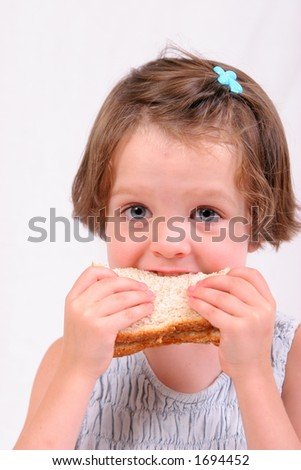 Little girl eating a sandwich, isolated over white