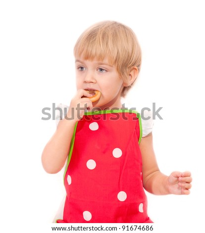 Little girl eating bagel isolated on white background