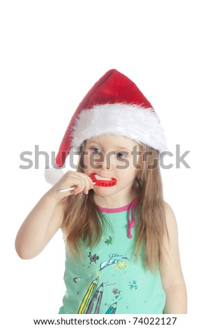 Little girl eating candy  lollipops on white background