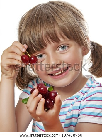 little girl eating cherries - stock photo