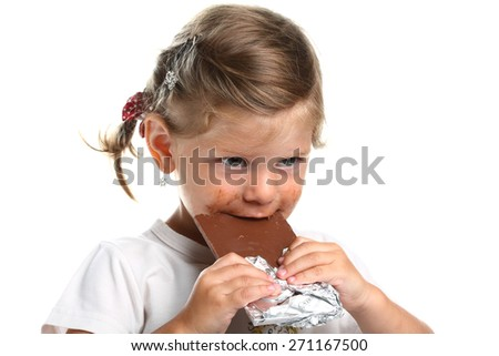 little girl eating chocolate . interesting emotions - stock photo