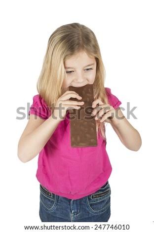 little girl eating chocolate isolated on white - stock photo