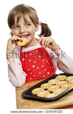 little girl eating cookies - stock photo