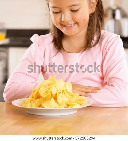 little girl eating corn flakes - stock photo