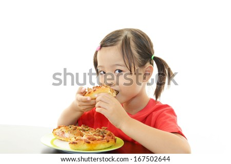 Little girl eating food - stock photo