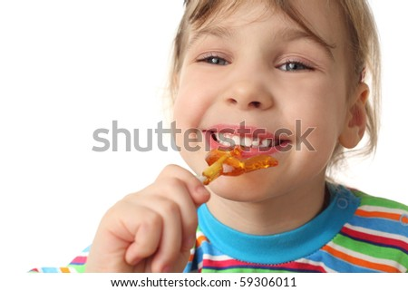 little girl eating orange lollipop, smiling and looking at camera, isolated on white