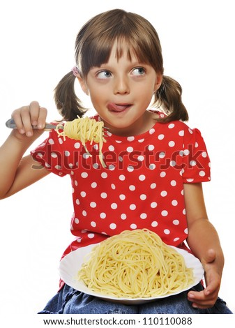 little girl eating spaghetti isolated on white background - stock photo