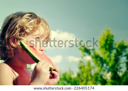 Little girl eating watermelon.  - stock photo