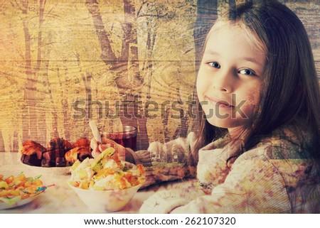 little girl eats fruit dessert in cafe - stock photo