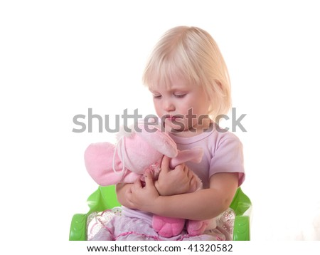 little girl embraces pink toy
