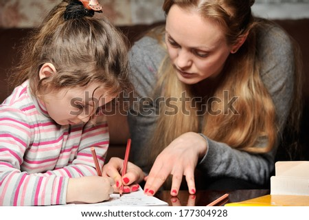 Little girl engaged with mother