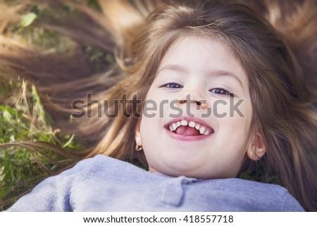 Little girl enjoy relax in nature - stock photo