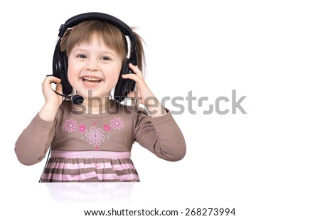 Little girl enjoying music using headphones, isolated over white - stock photo