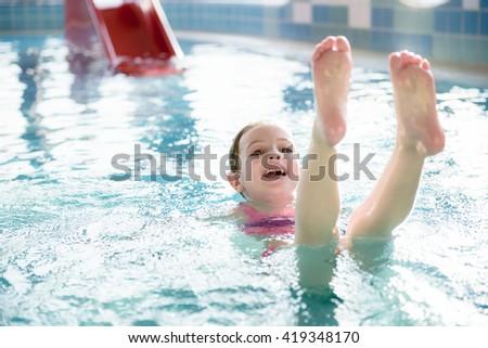 Little  Girl Enjoying Swimming at Indoor Pool - stock photo