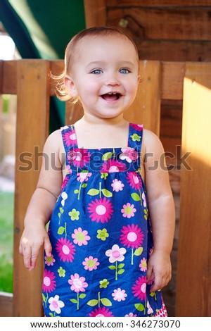 little girl enjoys summer laughs. - stock photo