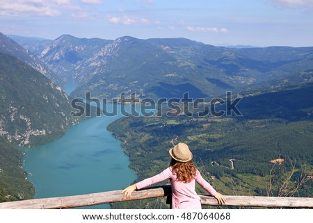 little girl enjoys the view from the viewpoint