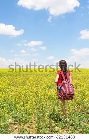 Little girl explores nature in summer time