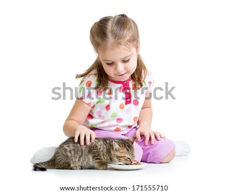 little girl feeding cat kitten - stock photo