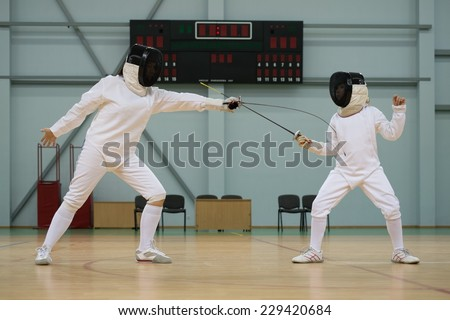 Little girl fencer and her trainer  - stock photo