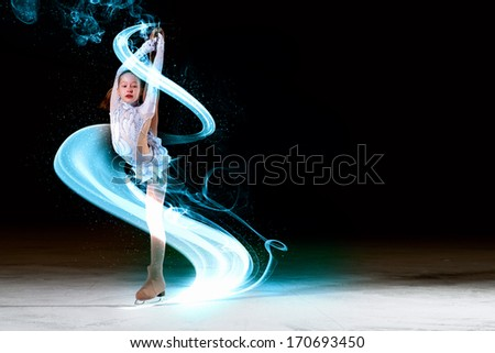 Little girl figure skating at sports arena - stock photo