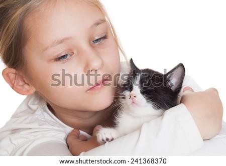 little girl gently hugs kitten - stock photo