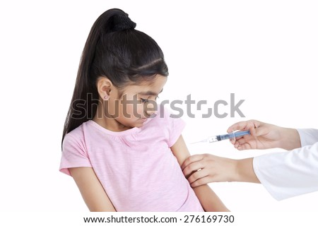 Little girl getting an injection - stock photo